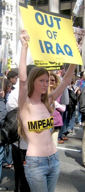 pretty anti-war protester with tape on her boobs
