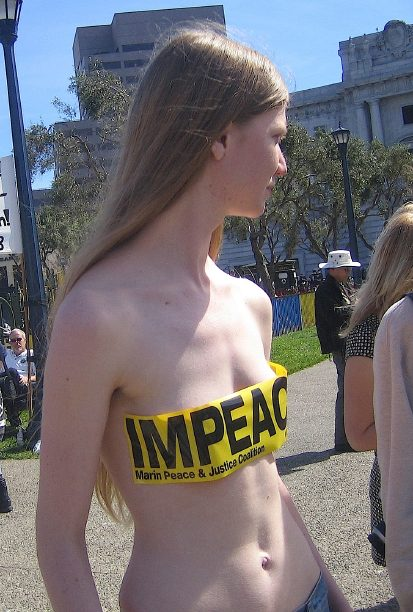 pretty girl goes almost naked to protest the war in iraq