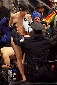 nude protester arrested by police