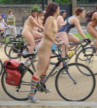 pretty nude cyclist woman wearingg nothing but fancy socks