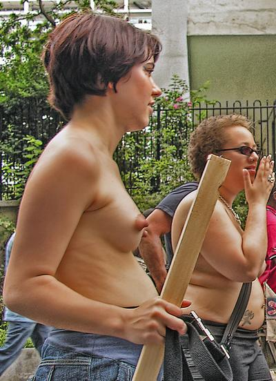 pretty naked protester with pert breasts
