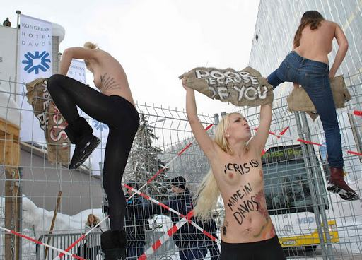 FEMEN nude protestes climbing crowd control fences in Davos