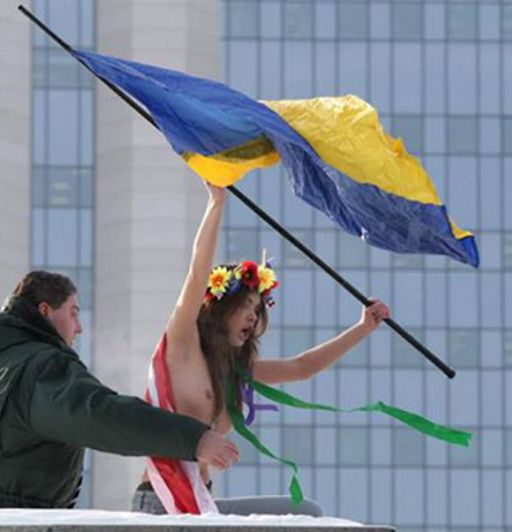 waving the flag at Gazprom in moscow -- topless