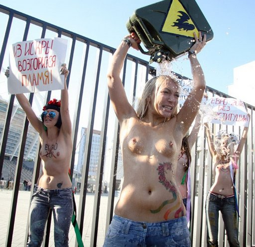FEMEN activists pretend to splash gasoline on themselves