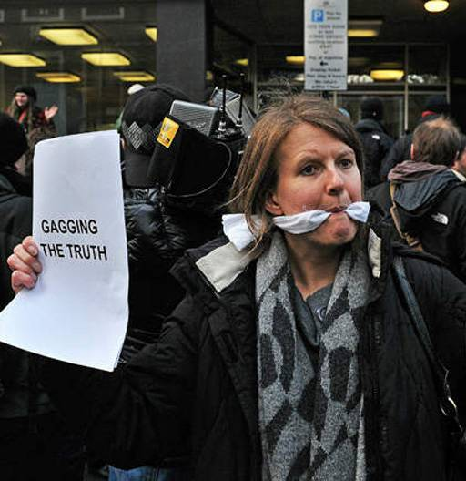 gagged wikileaks protester