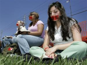 gagged women at sit-in