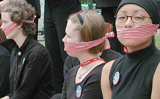 green peace girls with gagged mouths