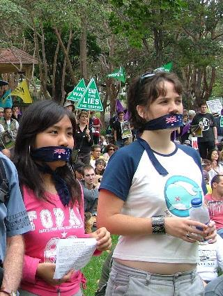 cute female war protesters wearing mouth gags