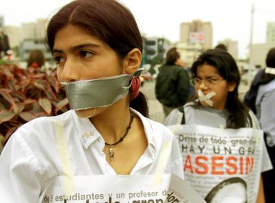 gagged women protesting