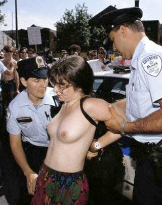 nude woman with pretty breasts being handcuffed by police
