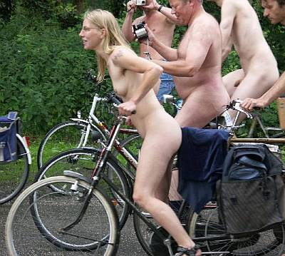 pretty naked blonde on bicycle