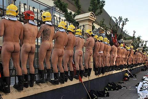 one hundred naked firemen protesting for better wages