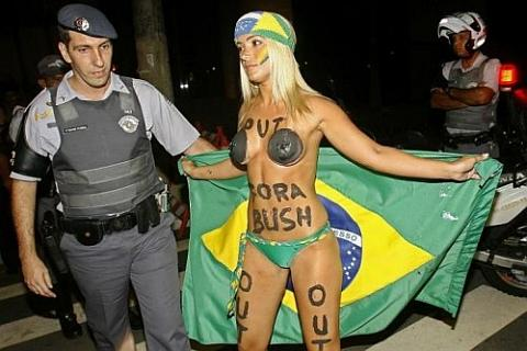 half naked protester against bush in brazil
