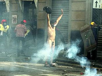 naked guy gets tear gas