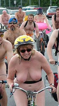 nude woman pedalling hard at the world naked bike ride
