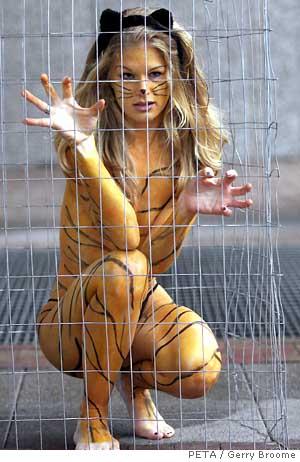 Lisa Franzetta - naked PETA activist in a cage