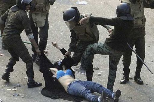 woman in egypt stripped by police and beaten during her arrest at a protest
